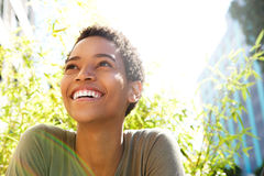 Beautiful young black woman smiling outdoors Royalty Free Stock Images