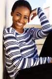 Beautiful young black woman smiling outside Stock Photo