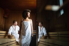 Beautiful woman relaxing in sauna and staying healthy stock photography