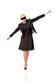Beautiful young blindfolded businesswoman trying walk Stock Photography