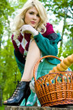Beautiful young blond with basket in summer park Stock Image