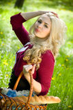 Beautiful young blond with basket in summer park Royalty Free Stock Image