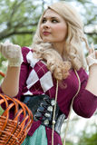 Beautiful young blond with basket in summer park Stock Photography