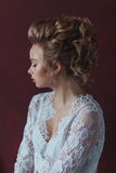 Beautiful young blond bride with fashion wedding hairstyle. Beautiful young bride with fashion wedding hairstyle Stock Photo