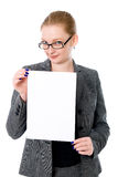Beautiful young blond business woman is holding blank whiteboard. Sign. Isolated on white background Royalty Free Stock Photos