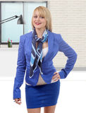 Beautiful young and blond businesswoman with blue suit Royalty Free Stock Photos