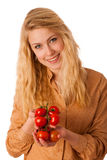 Beautiful young blond caucasian cheerful woman with blue eyes ho Stock Photo