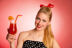 Beautiful young blond caucasian  pinup woman with a glass of coc Royalty Free Stock Photos