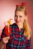 Beautiful young blond caucasian  pinup woman with a glass of coc Stock Photography