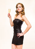 Beautiful young blond with champagne glass. Stock Images