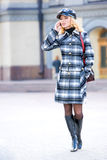 Beautiful young blond in a coat Royalty Free Stock Photos