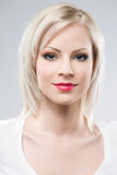 Beautiful young blond in elegant makeup. Royalty Free Stock Photo