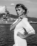 Beautiful young blond female model on a pier Stock Photography