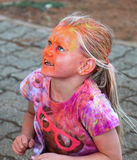 Beautiful young blond girl covered with powder paint at colour r Royalty Free Stock Photos