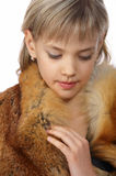 Beautiful young blond girl in fur Stock Photos