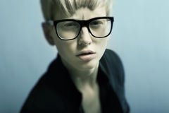 Beautiful young blond girl with glasses. Beautiful young blond girl with black glasses Royalty Free Stock Image