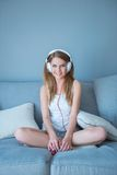 Beautiful young blond girl listening to music Royalty Free Stock Images