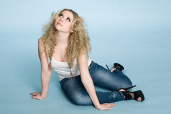 Beautiful young blond girl looking up. Royalty Free Stock Photography
