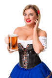 Beautiful young blond girl of oktoberfest beer stein Royalty Free Stock Photos