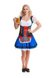 Beautiful young blond girl of oktoberfest beer stein. Beautiful young blond girl in dirndl drinks out of oktoberfest beer stein. Isolated on white background Royalty Free Stock Photo