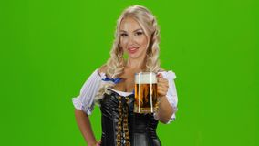 Beautiful young blond girl of oktoberfest beer stein stock video footage