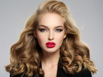 Beautiful young blond girl with red lips. royalty free stock photography