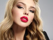Beautiful young blond girl with red lips. stock images