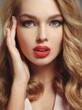 Beautiful young blond girl with sexy red lips. Photo of a beautiful young blond girl with sexy red lips. Closeup attractive sensual face of white woman with Stock Photography