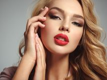 Beautiful young blond girl with sexy red lips. Photo of a beautiful young blond girl with sexy red lips. Closeup attractive sensual face of white woman with Stock Images