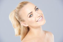 Beautiful young blond with her hair in a ponytail Royalty Free Stock Photos