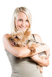 Beautiful young blond holding cute yorkie dog. Portrait of Beautiful young blond girl holding cute yorkie, isolated on white background Stock Photo