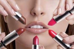 Beautiful young blond model  applying lipstick Stock Photos