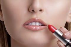 Beautiful young blond model  applying lipstick Stock Photo