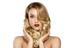 Beautiful young blond model curly hair posing Stock Image