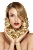 Beautiful young blond model curly hair posing Royalty Free Stock Images