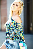 Beautiful young blond model girl in summer hipster clothes with skateboard Stock Photography