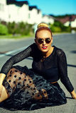 Beautiful young blond model girl in summer hipster clothes in the street Royalty Free Stock Photo
