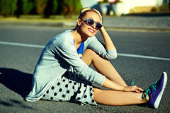 Beautiful young blond model girl in summer hipster clothes in the street Stock Photography
