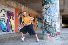 Beautiful young blond model. Graffiti Stock Photography