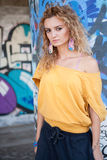 Beautiful young blond model. Graffiti Stock Images