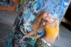 Beautiful young blond model. Graffiti Stock Photo