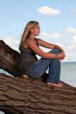 Beautiful young blond model on tree Stock Photo