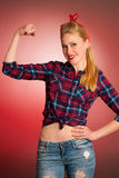 Beautiful young blond Pinup woman gesturing we can do it over re Royalty Free Stock Photography