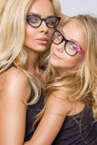Beautiful Young Blond Sexy Mom Of An Adorable Little Baby Girl With Long Hair In Black Glasses Snuggling And Looking The Lens