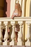 A beautiful young blond sexy woman. A beautiful young blond sexy woman standing near the railing Stock Photography