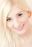 Beautiful young blond smiling woman closeup portrait Stock Images