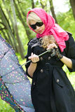 Beautiful young blond in summer park Stock Image