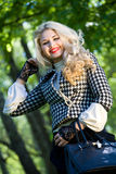 Beautiful young blond in summer park Royalty Free Stock Images