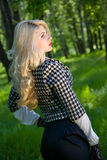 Beautiful young blond in summer park Stock Photography