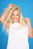 Beautiful young blond with a vivacious smile Stock Photo
